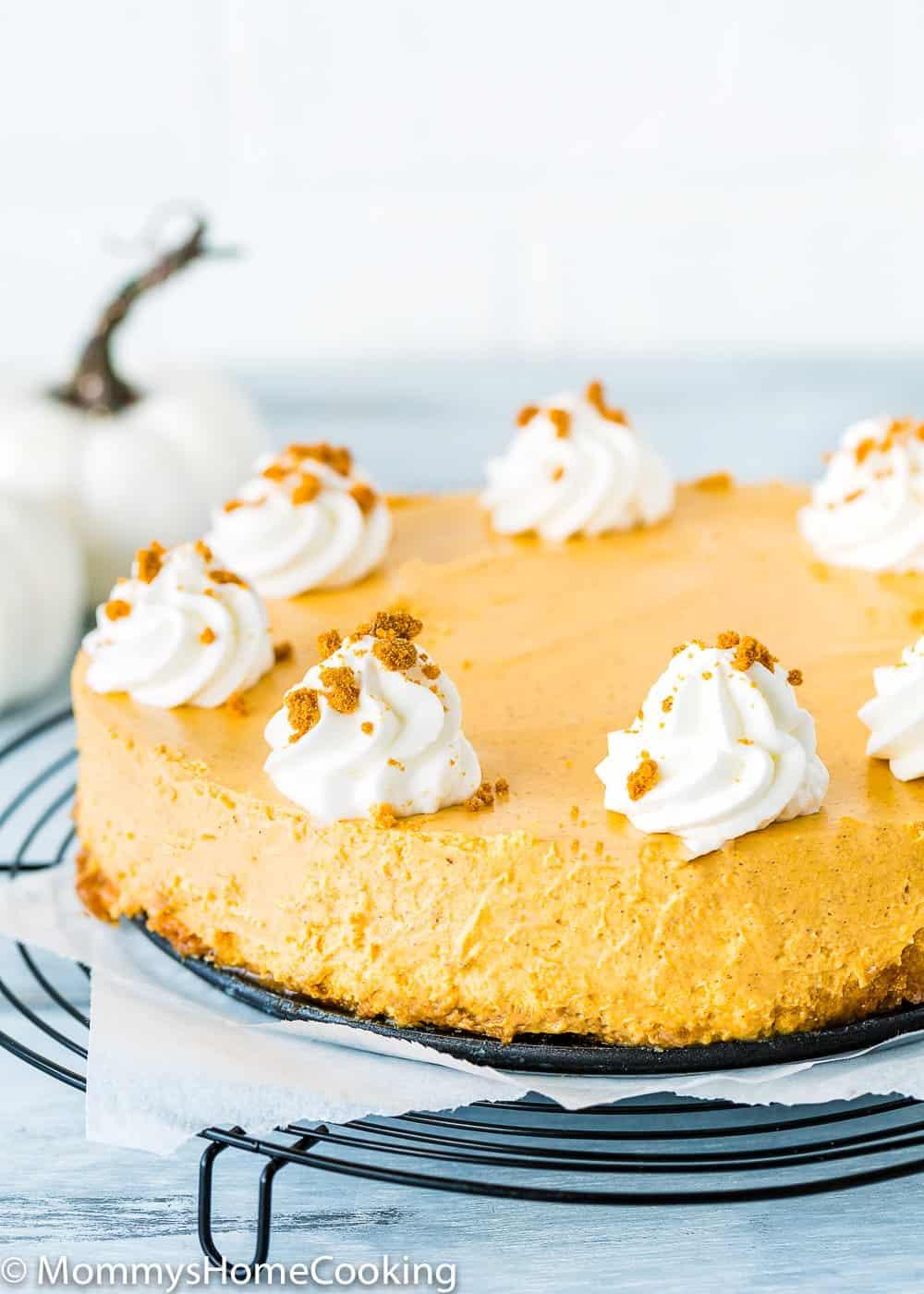 Eggless Pumpkin Cheesecake over a cooling rack