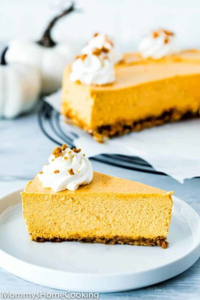 slice of eggless pumpkin cheesecake in a white plate