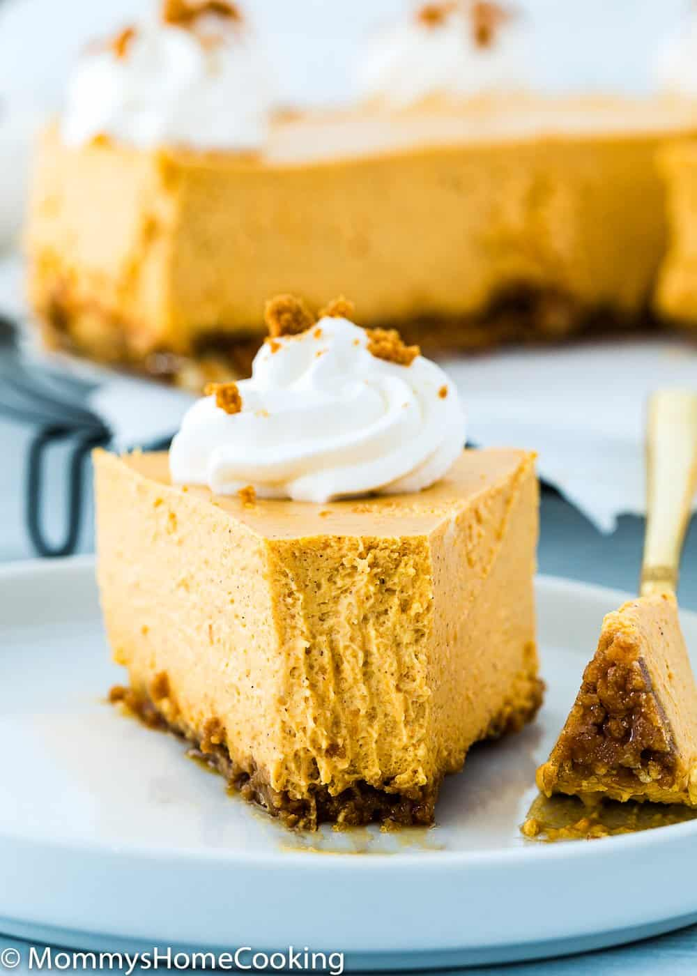 perfect slide of eggless pumpkin cheesecake with a fork