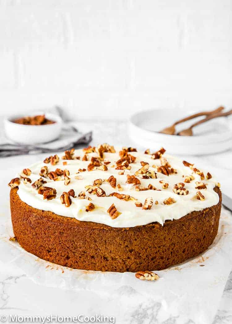 Easy eggless banana cake with cream cheese frosting and chopped pecans