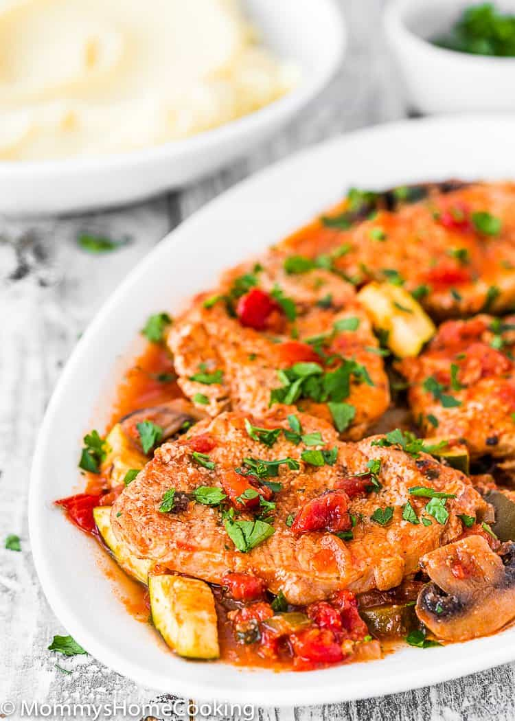 Easy Instant Pot Italian Pork Chops in a serving plate