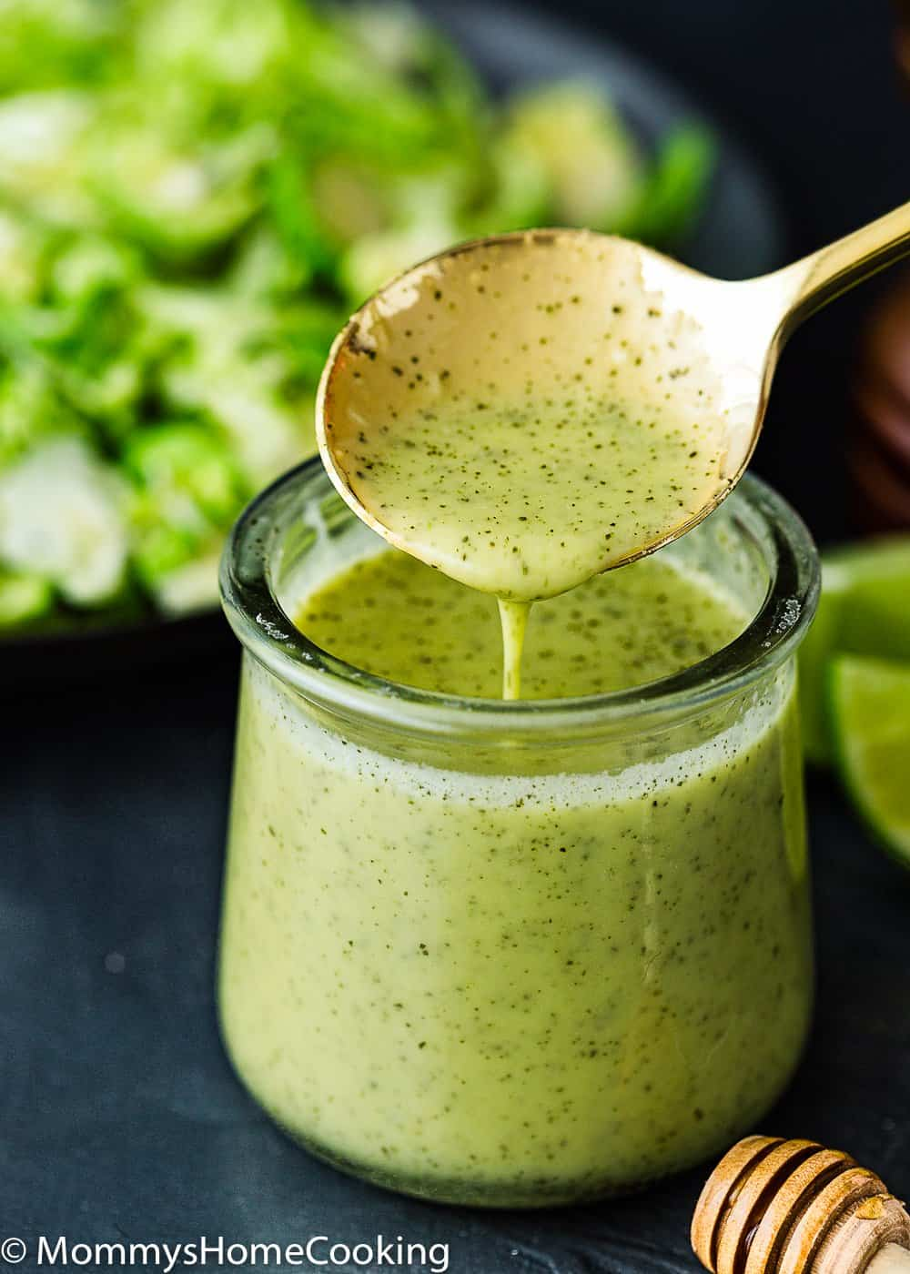 Green onion vinaigrette in a container with a spoon