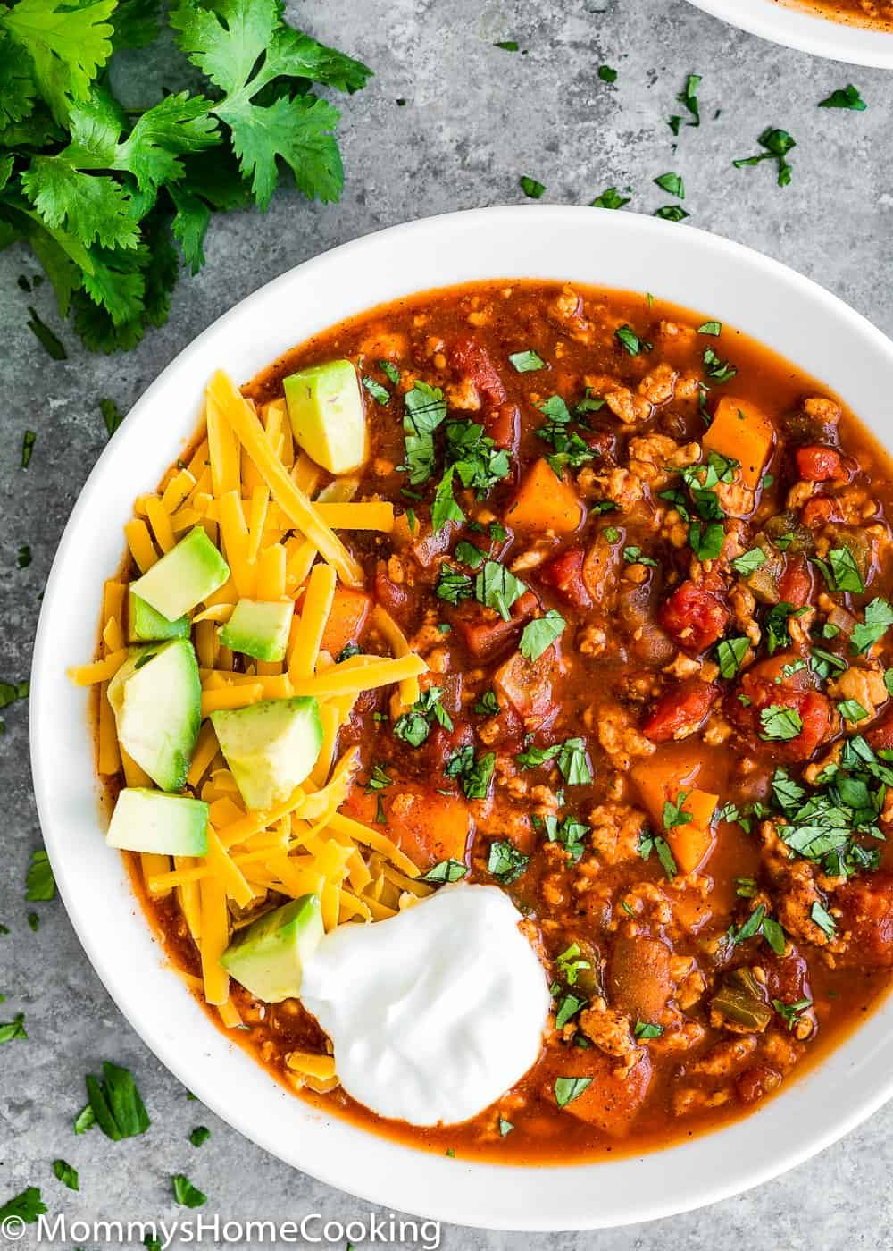 Healthy Low Carb Turkey Chili bowl with avocado, cheese and sour cream