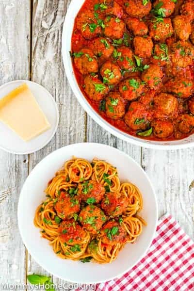 A plate of spaghetti and eggless meatballs