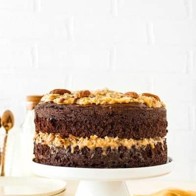 Eggless German Chocolate Cake in a cake stand
