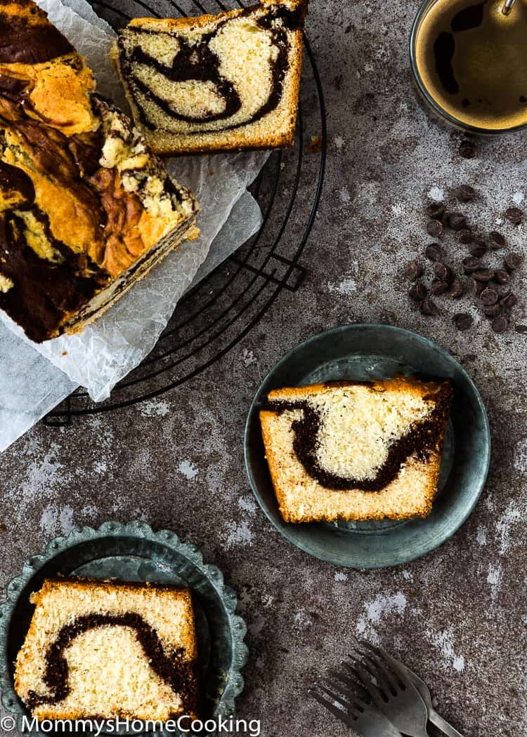 Eggless Marble Cake slice on a metal plate
