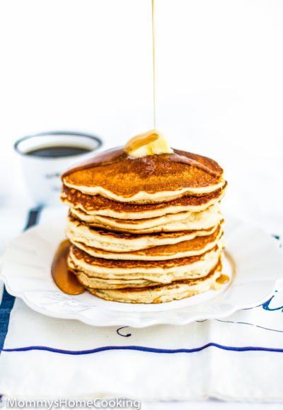 Eggless Pancakes stack with butter and syrup