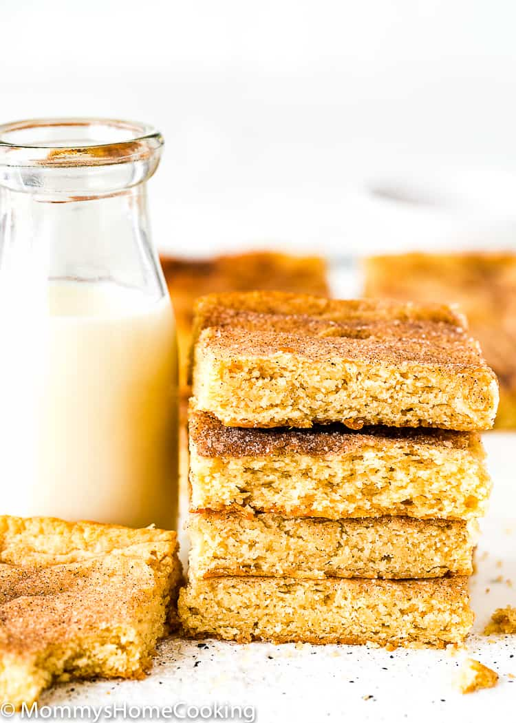 Stack of Eggless Snickerdoodle Bars with a glass of milk