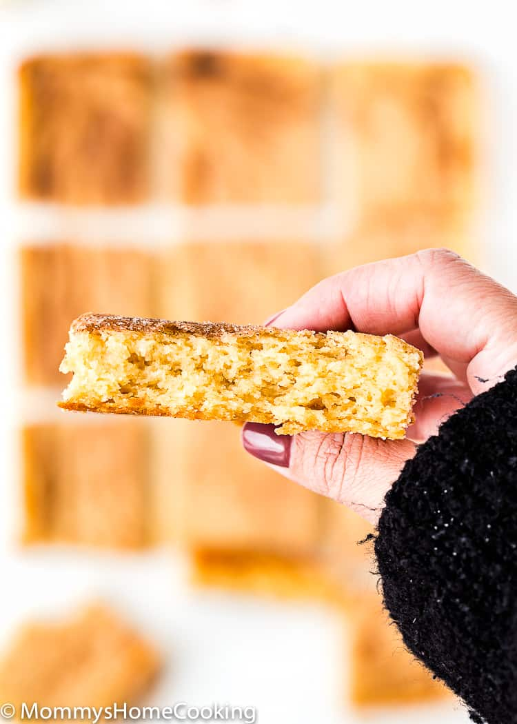 a hand showing the inside of an Eggless Snickerdoodle Bar