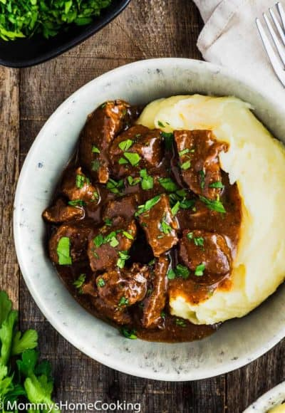 Beef Tips with Gravy and mashed potatoes in a bowl