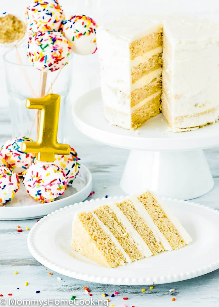eggless smash cake in a cake stand and a slice of cake in a plate