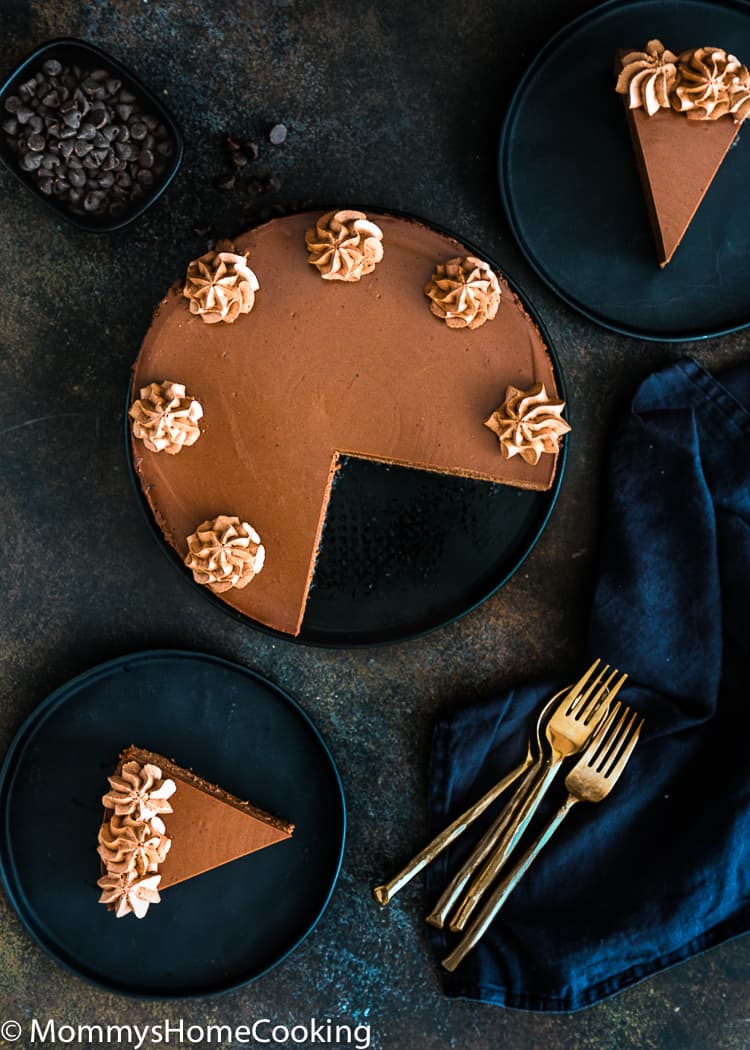 Eggless Chocolate cheesecake in a plate with two slices on the side