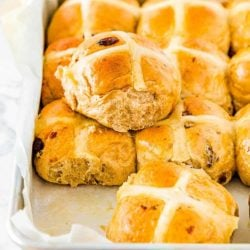Eggless Easter Hot Cross Buns in a baking pan