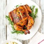 Easy Venezuelan Roasted Chicken in a serving plate