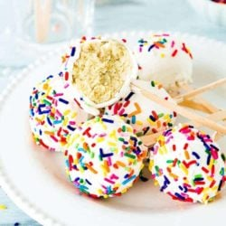 Easy Eggless Homemade Cake Pops in a white plate showing the inside texture