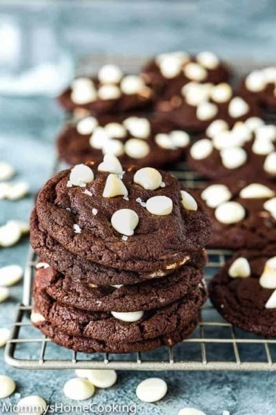 Eggless White Chip Chocolate Cookies over a cooling rack