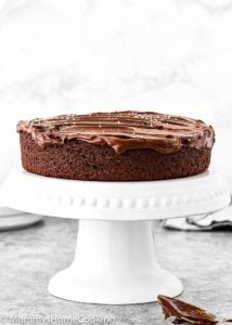 One Bowl Eggless Chocolate Cake with chocolate ganache in a cake stand