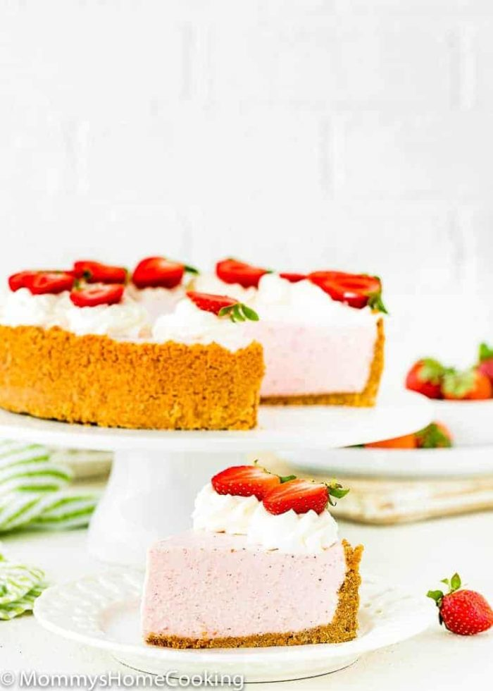 Best No-Bake Strawberry Cheesecake decorated with whipped cream and fresh strawberries