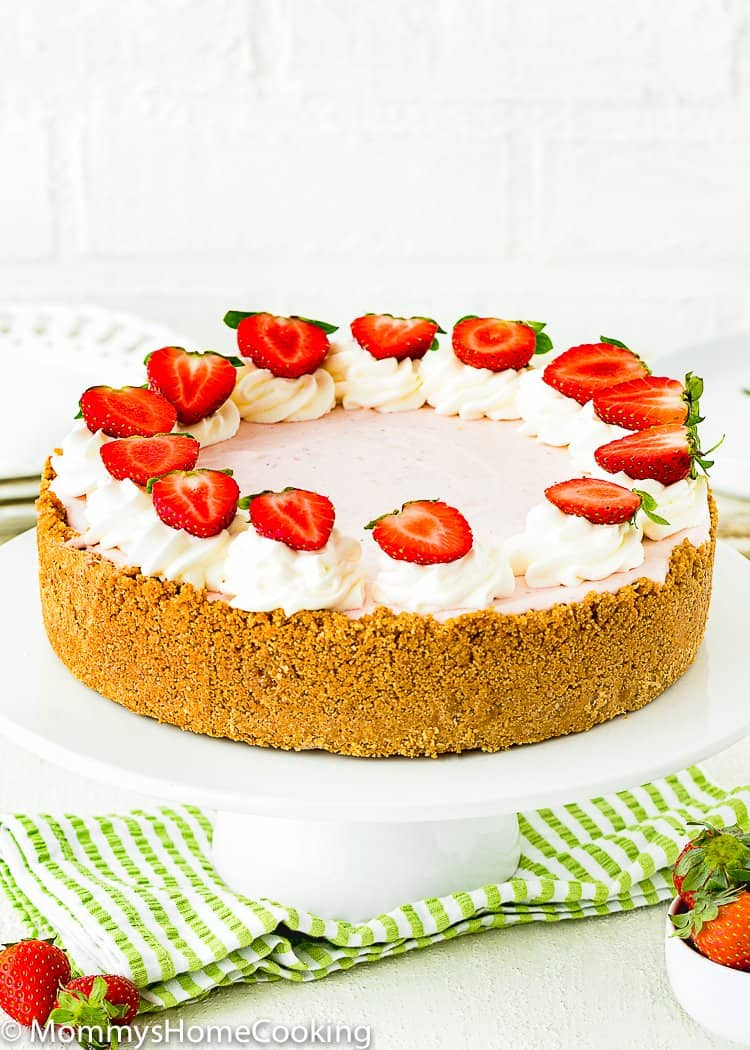 Best No-Bake Strawberry Cheesecake  over a cake stand