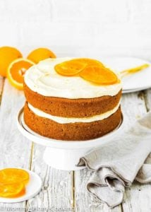 Easy Eggless Orange Cake on cake stand