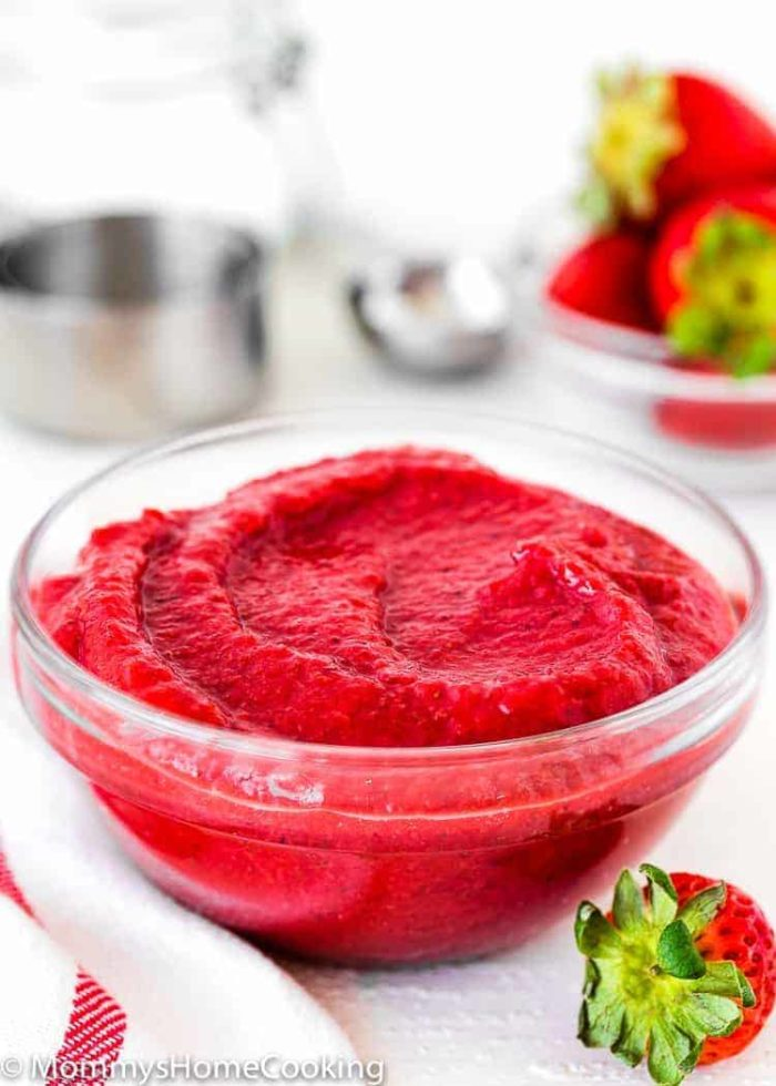 Easy homemade strawberry puree in a glass bowl