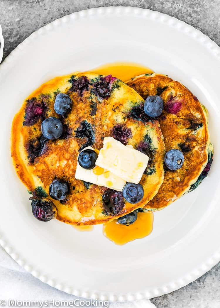 two egg free blueberry pancakes on a plate