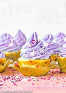 easy Eggless Confetti Cupcakes with purple buttercream and sprinkles