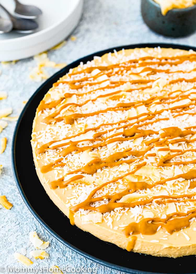 No-Bake Eggless Dulce de Leche Cheesecake with coconut flakes and dulce de leche drizzle