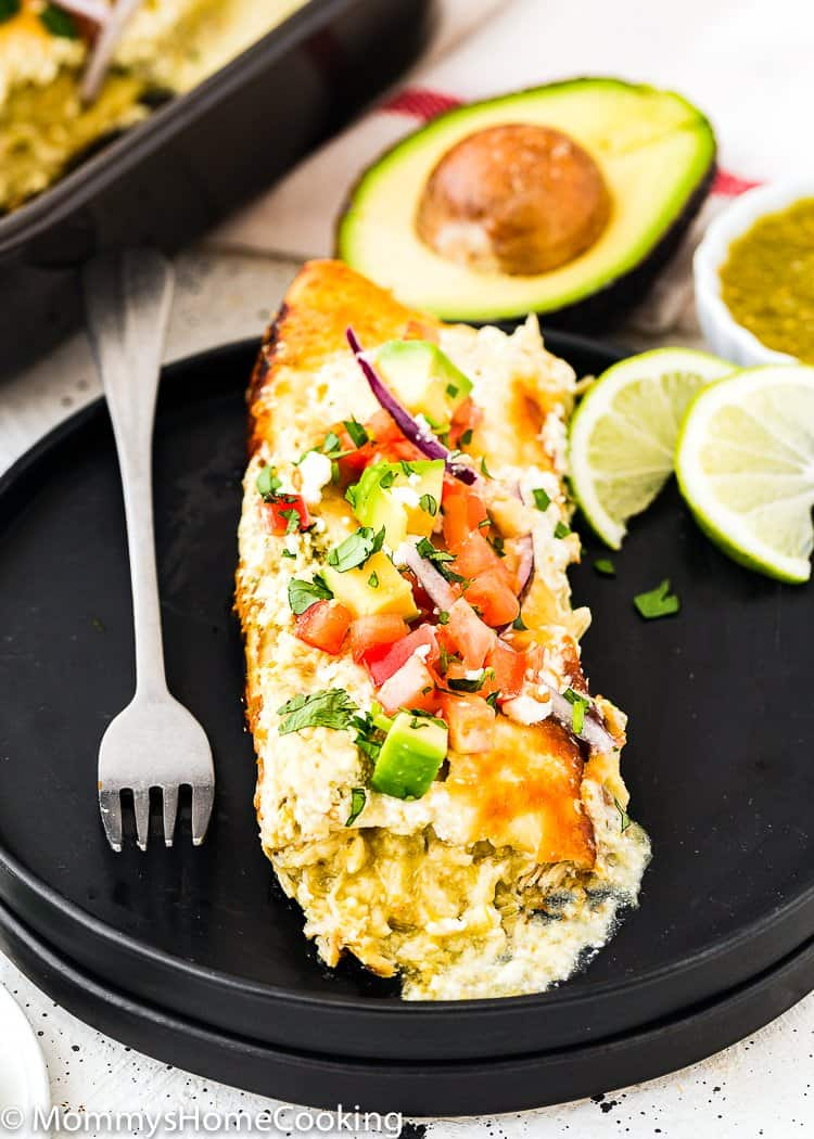 Easy Enchilada Suiza in a plate with toppings