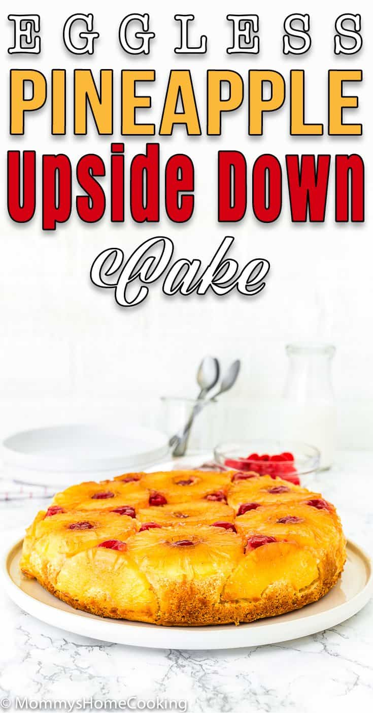 a whole Eggless Pineapple Upside Down Cake over a cake plate with text overlay