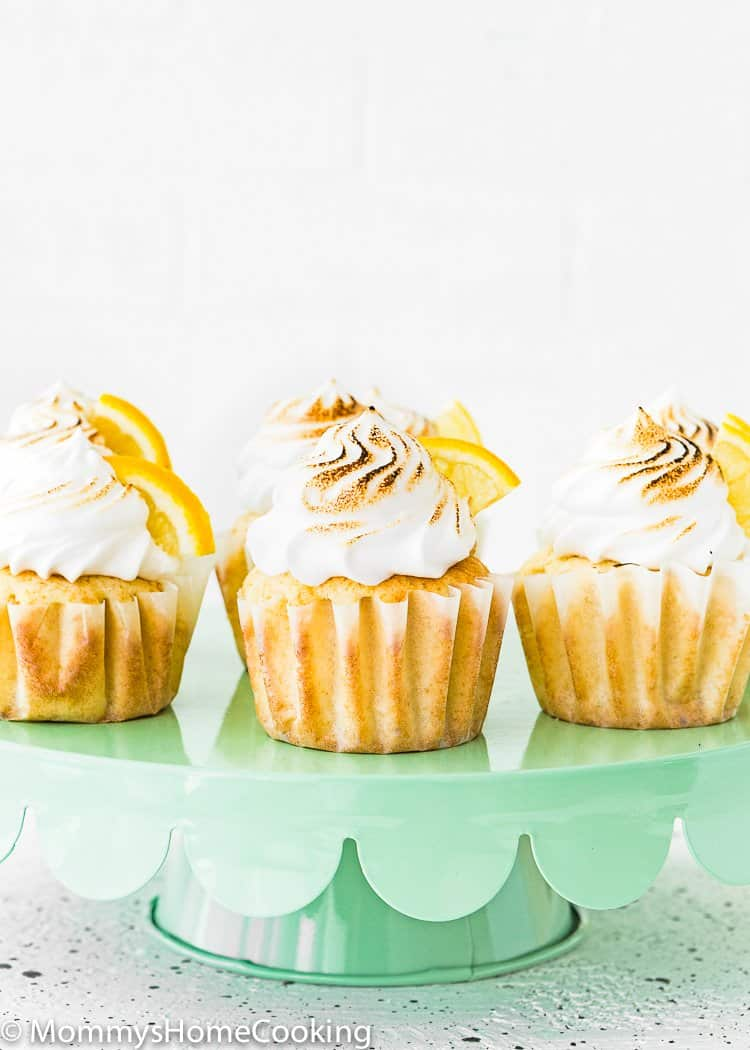 Eggless Lemon Meringue Cupcakes on a green cake stand