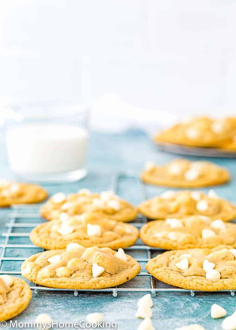Eggless White Chocolate Chips Cookies over a cooling rack