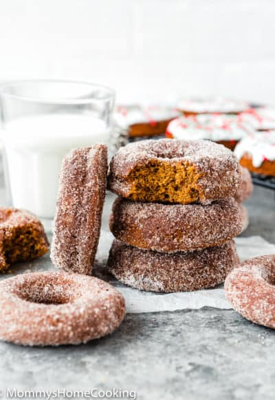 Eggless Gingerbread Donuts stack with a glass of milk