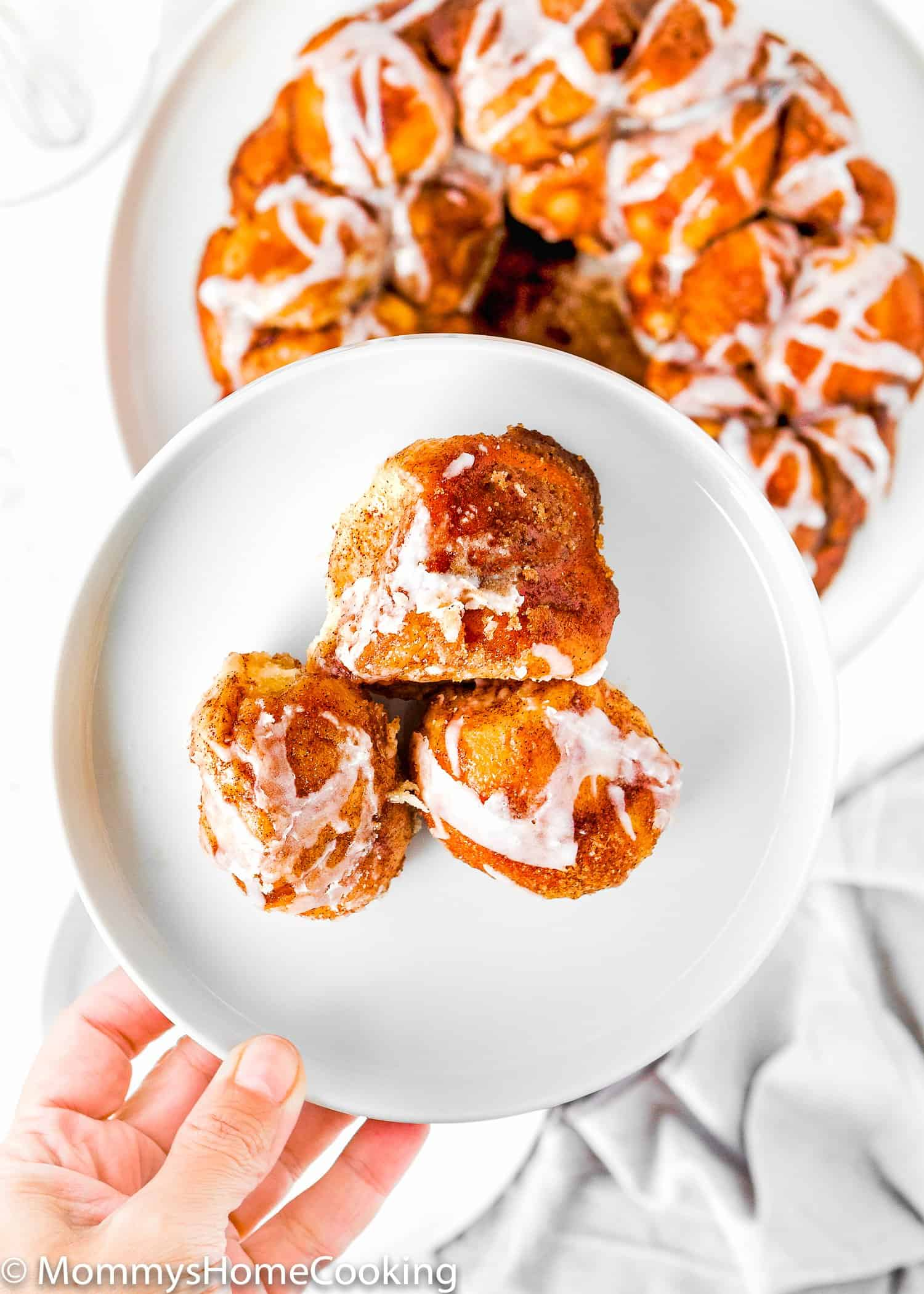 three pieces of Homemade Eggless Monkey Bread on a plate