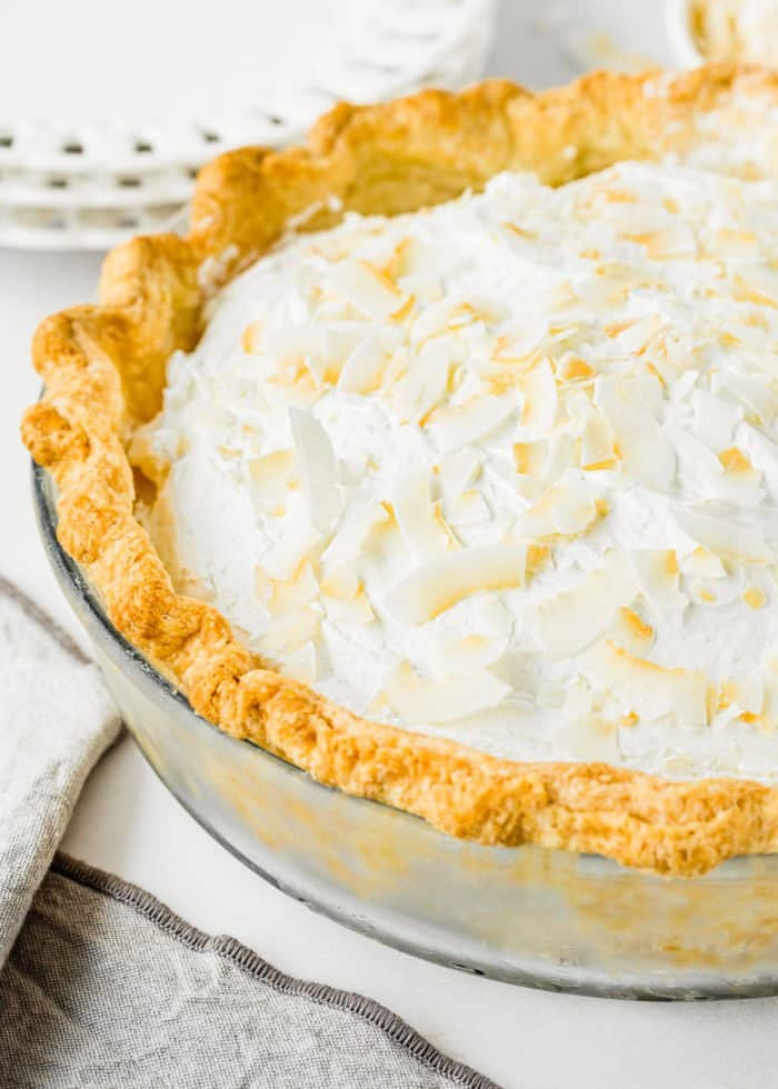 Eggless Coconut Cream Pie topped with whipped cream