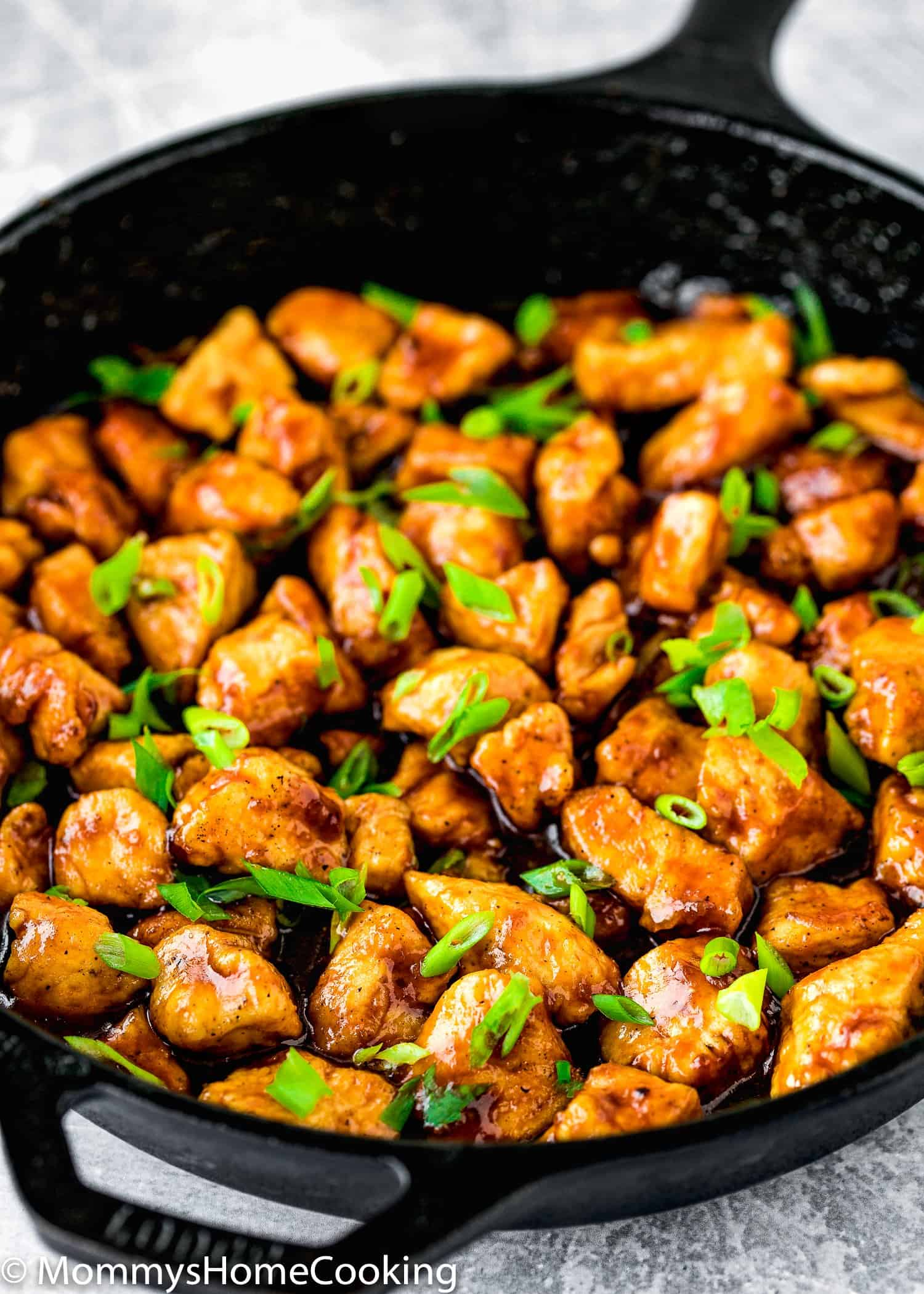 Easy Sticky Bourbon Chicken with sliced green onions