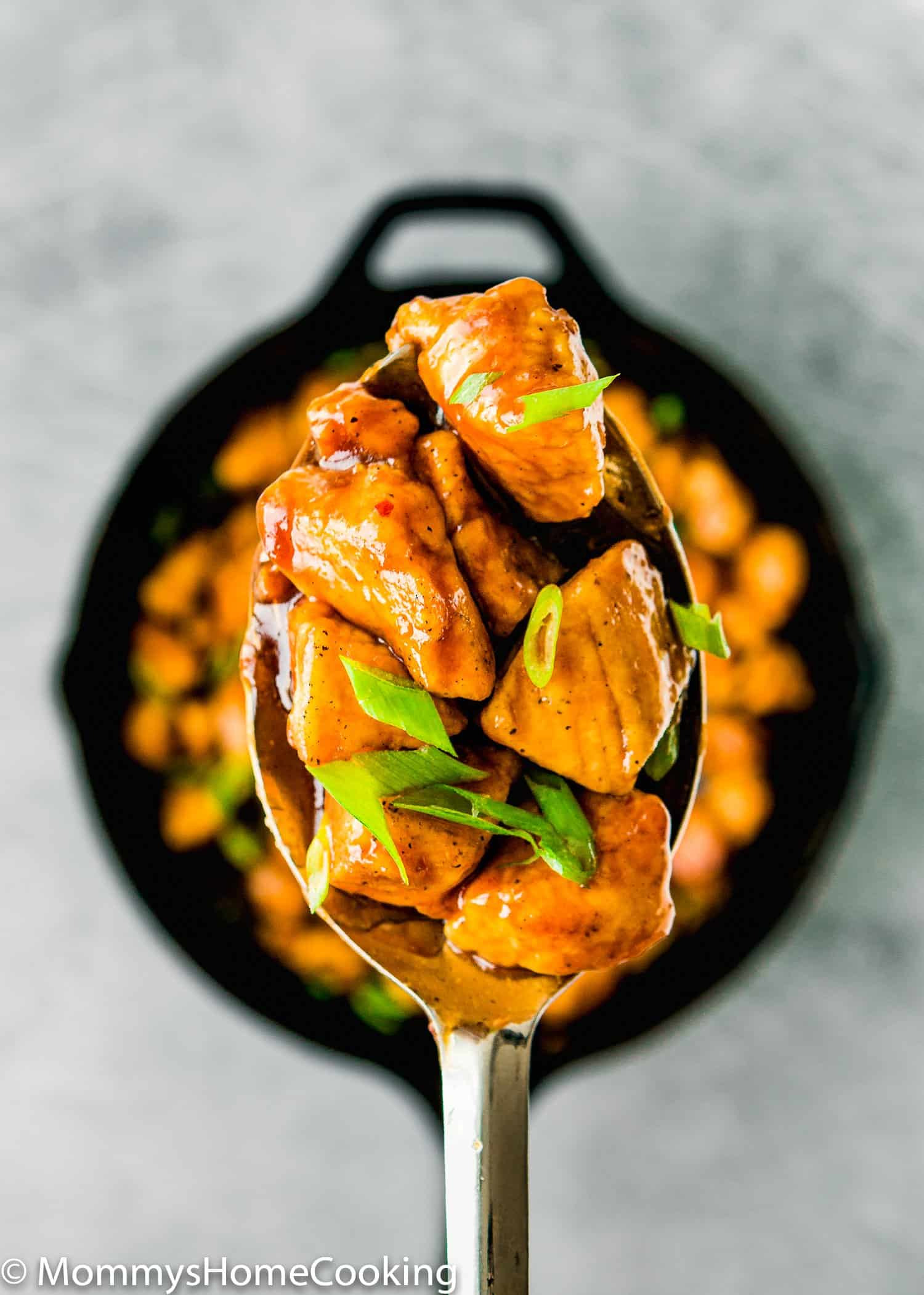 How to Make Easy Sticky Bourbon Chicken on a serving spoon