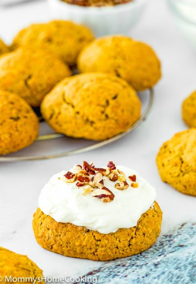 Eggless Carrot Cake Cookie with cream cheese frosting and chopped pecan on top