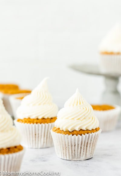 eggless carrots cupcakes frosted with cream cheese frosting that isn't runny