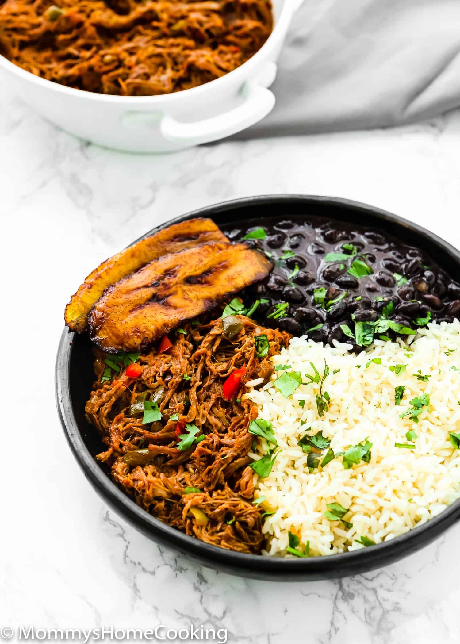 Venezuelan Shredded Beef on a plate with beans and rice for Pabellon Criollo.