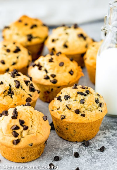 Eggless Bakery-Style Chocolate Chip Muffins over a gray surface