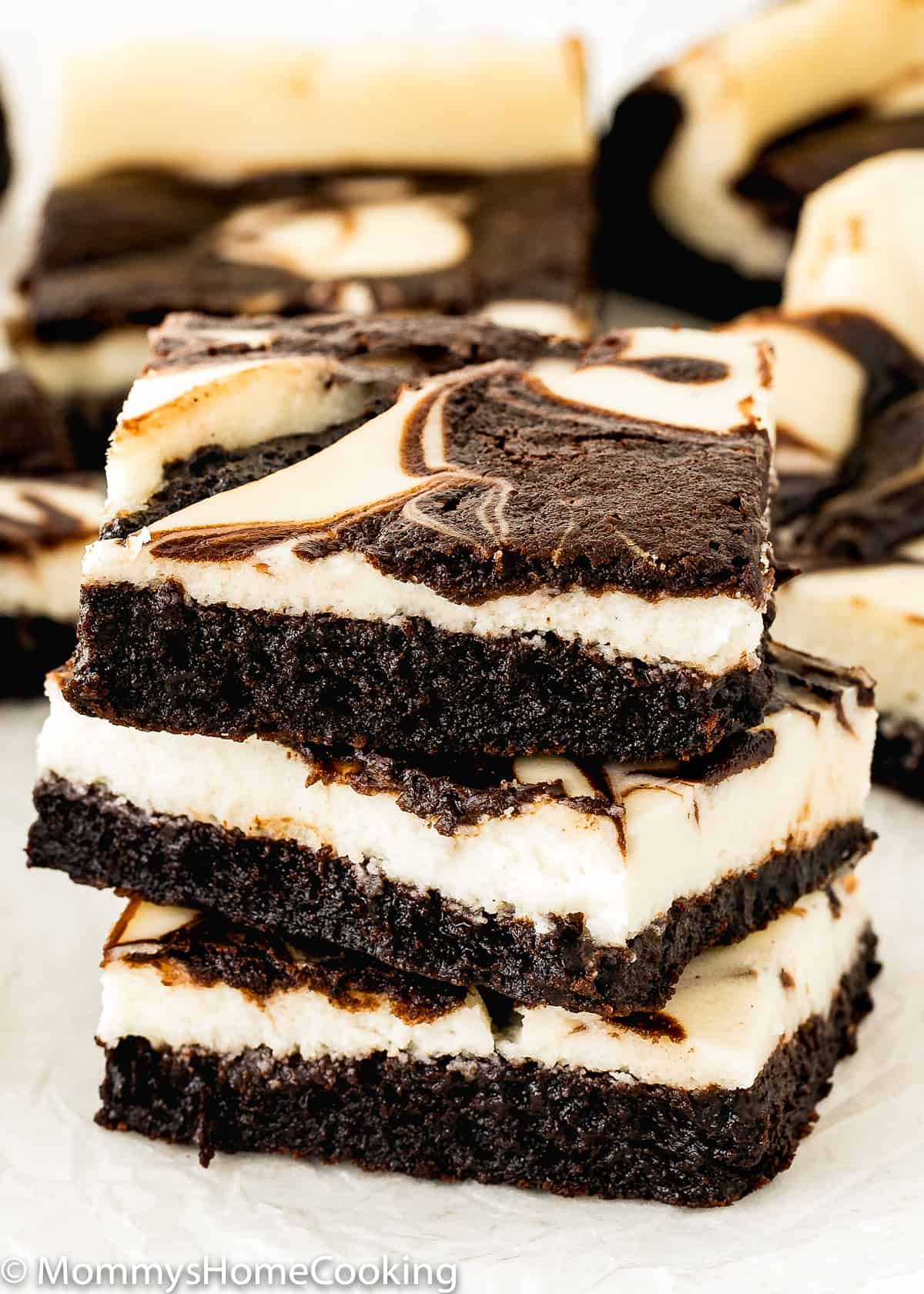 3 eggless cheesecake brownies stack together