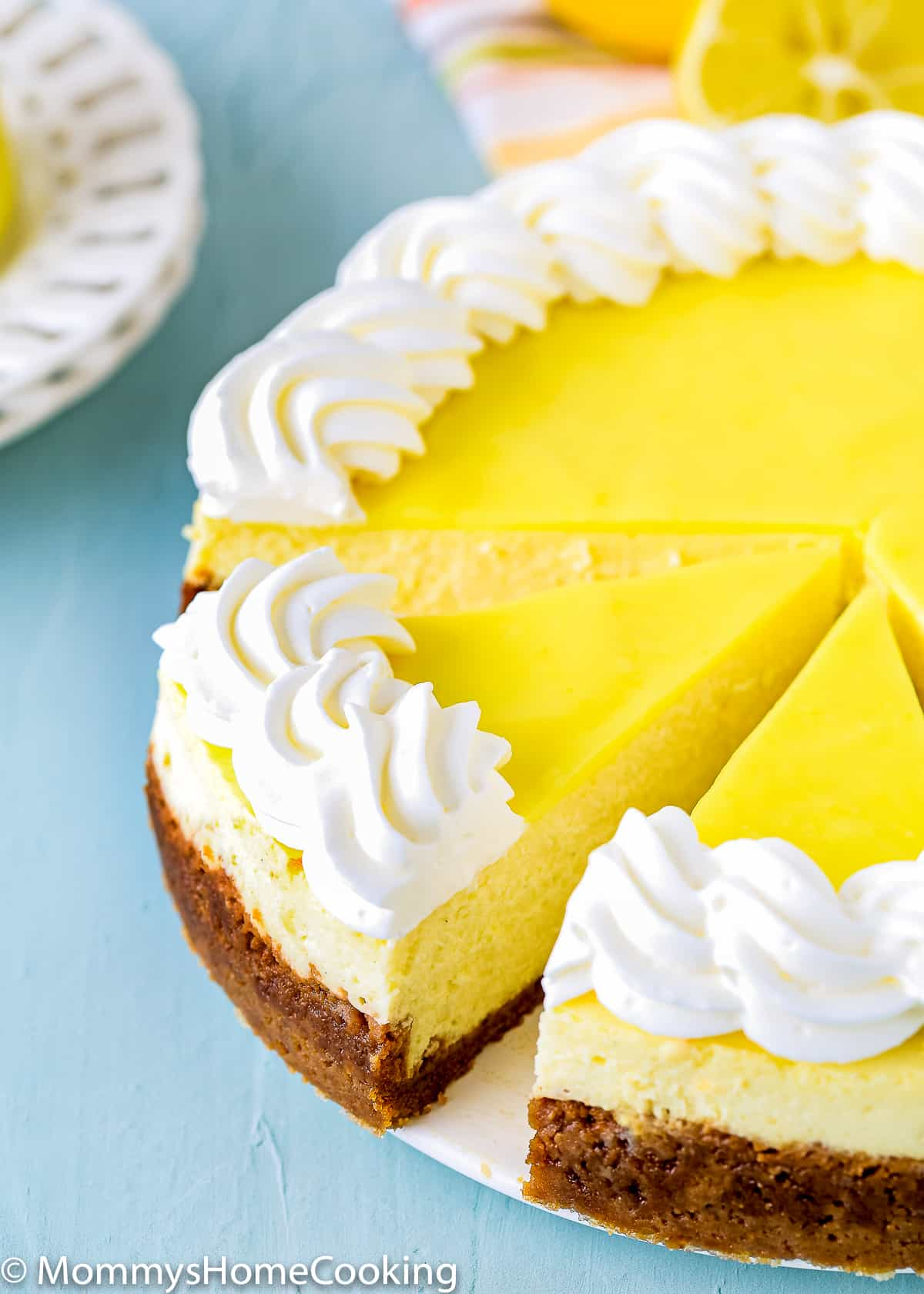 sliced eggless lemon cheesecake over a white serving plate