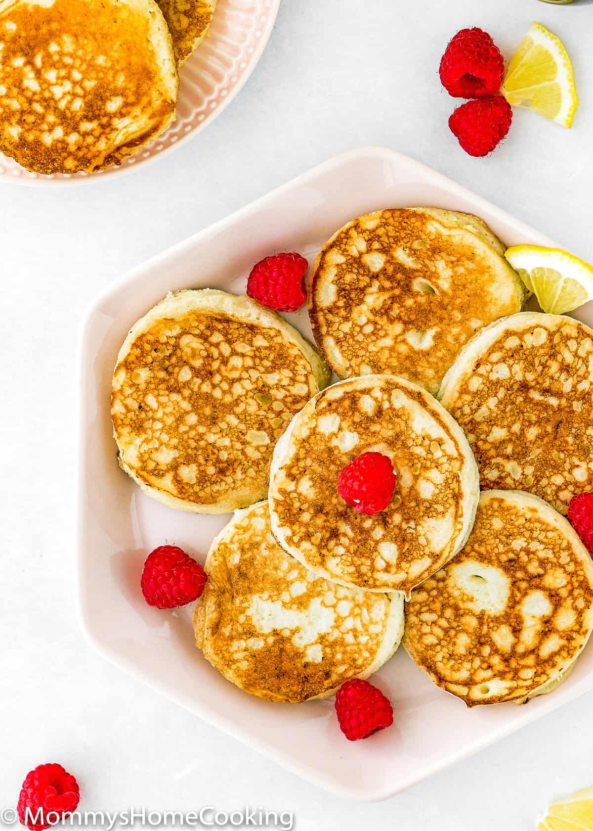 overhead view of a plate of eggless lemon ricotta pancakes
