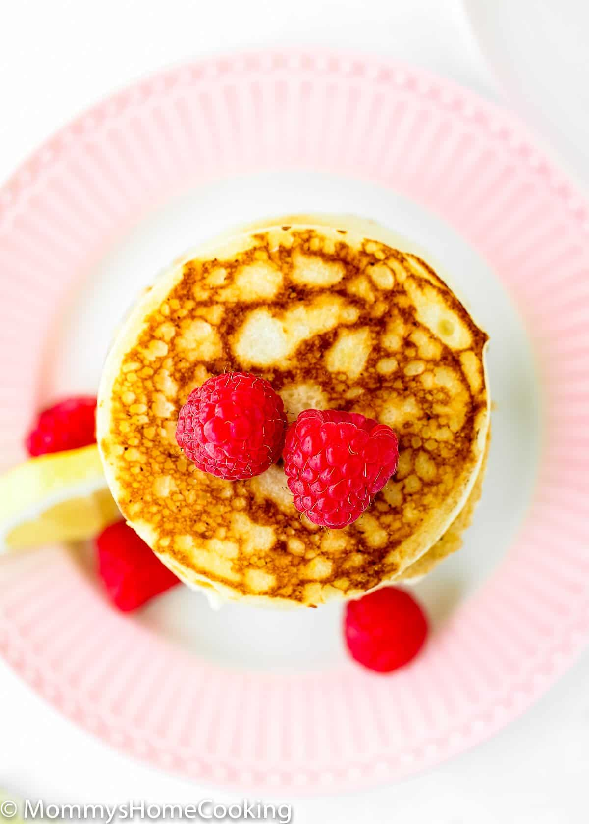 overhead view of a eggless lemon ricotta pancakes stack.