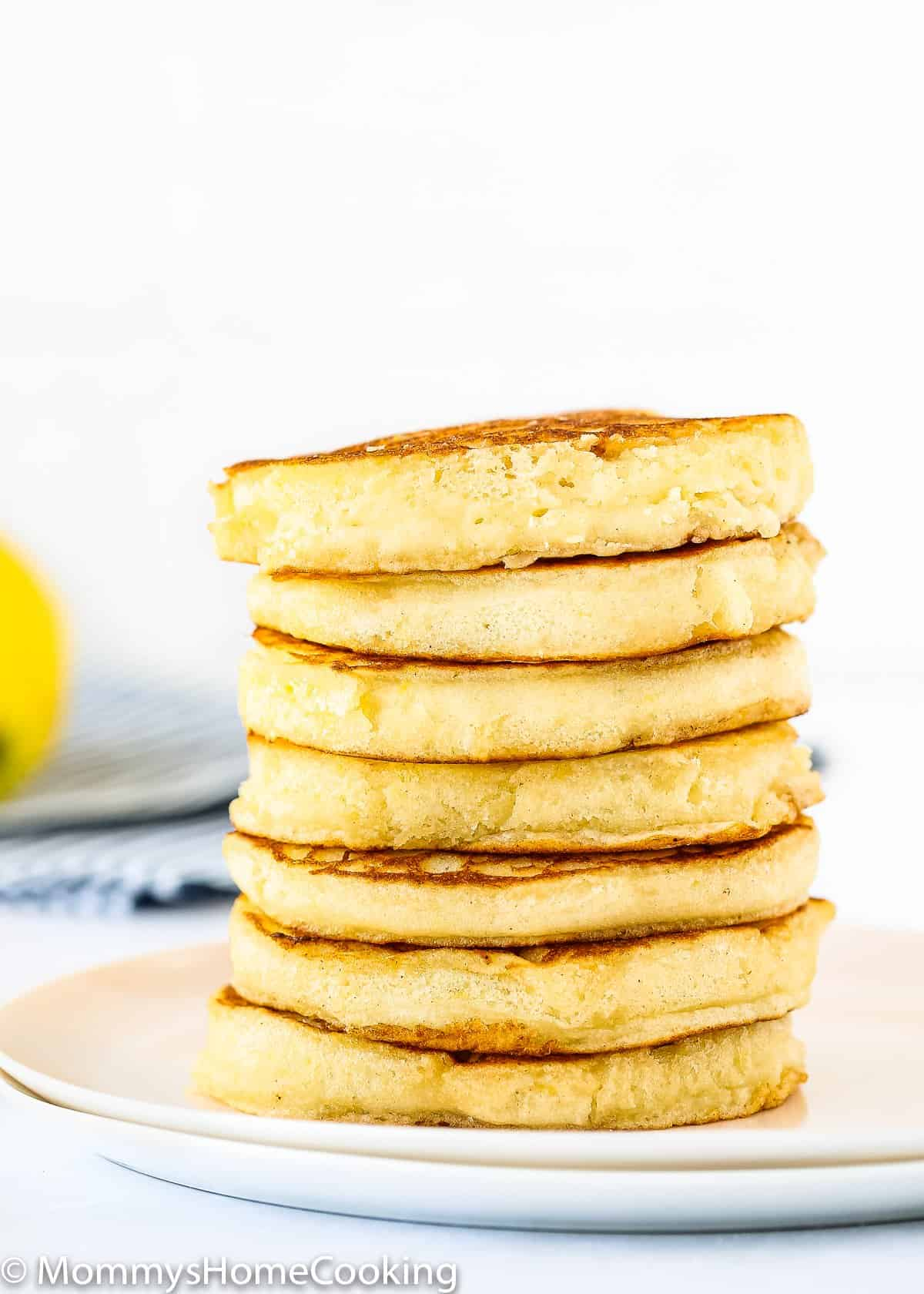 stack of eggless lemon Ricotta pancakes on a plate
