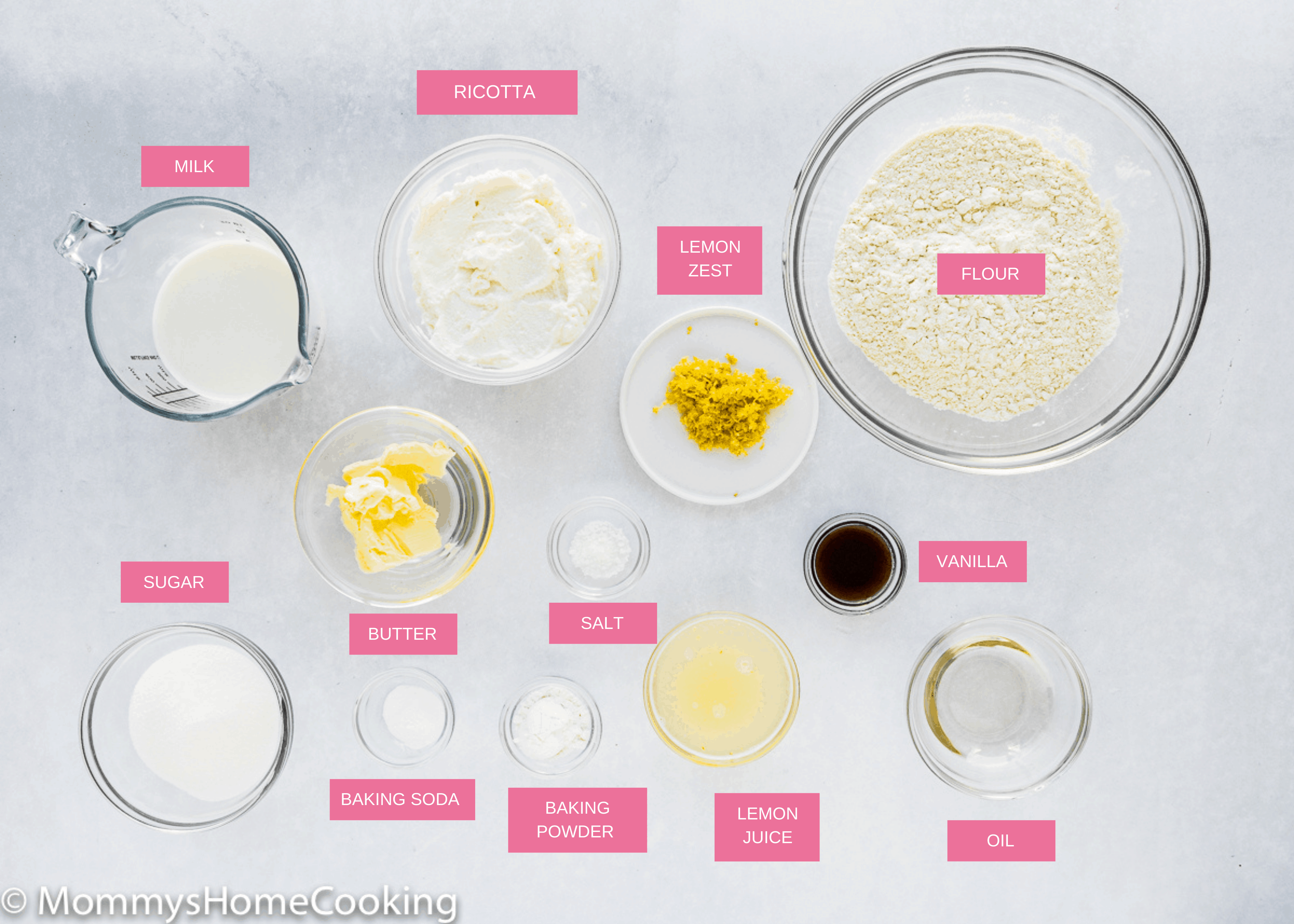eggless lemon ricotta pancakes ingredients over a gray surface.