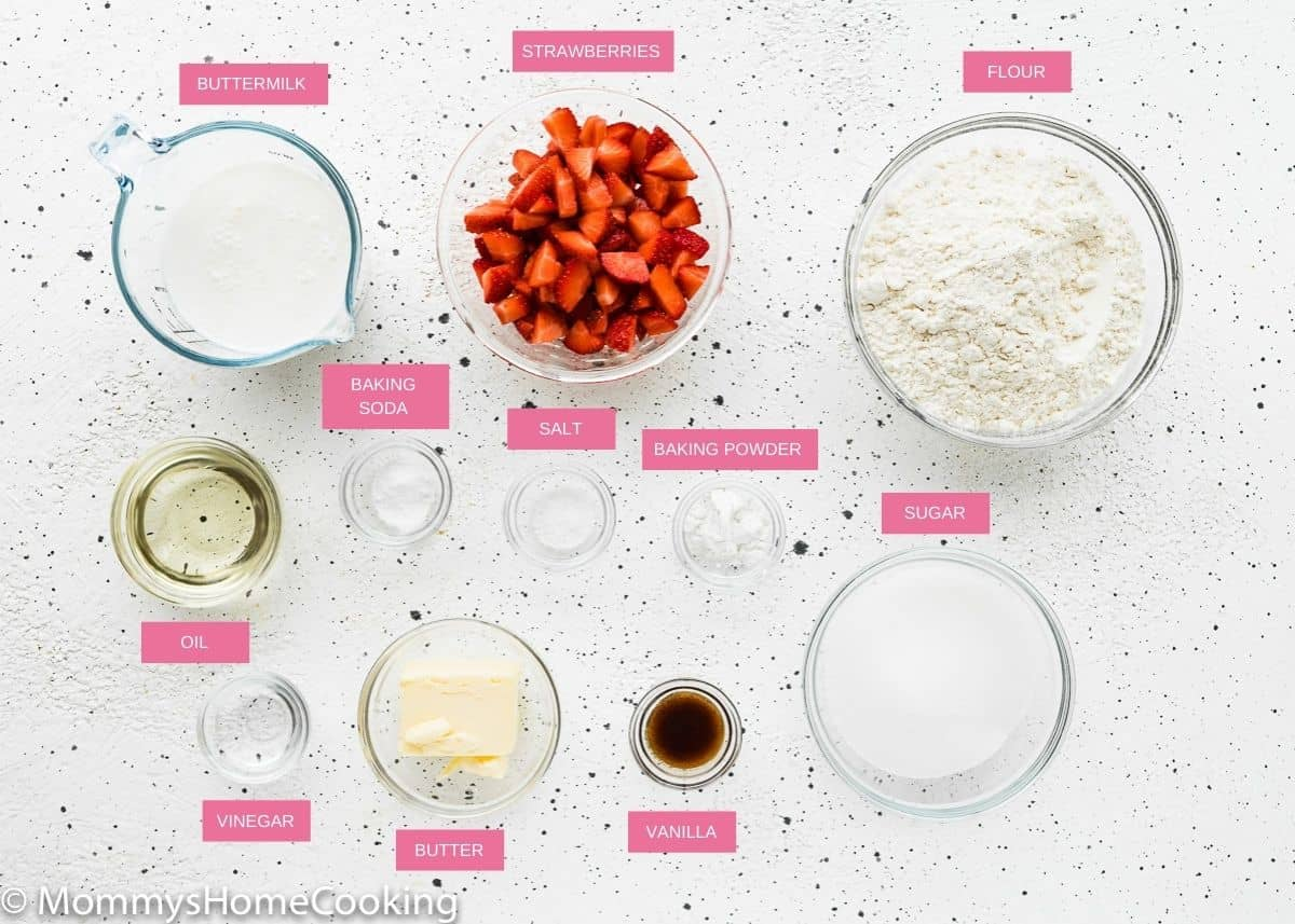 eggless strawberry muffins ingredients over a white surface